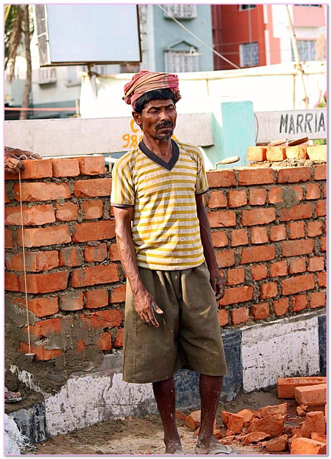 Person Who Does Work Stone Masonry Construction. Stone Wall